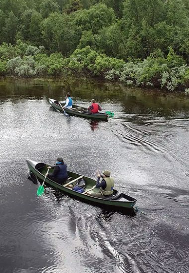 Paddle canoe along the River Muonio